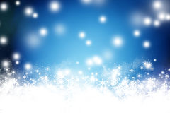 Abstract blue Christmas background with white snowflakes Royalty Free Stock Photo