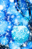 Abstract Blue Christmas Blurred Background. With Bauble Hanging and Drawn Snow. Shallow Depth of Field, Selective Focus. Bokeh Lights. Festive Mood Stock Photos