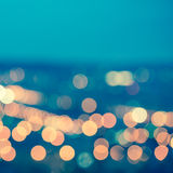 Abstract blue circular bokeh background, city lights with horizo Stock Image