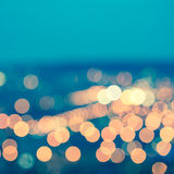 Abstract blue circular bokeh background, city lights with horizon, toned style, closeup stock image