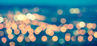 abstract blue circular bokeh background, city lights with horizon, toned style, panorama stock photos