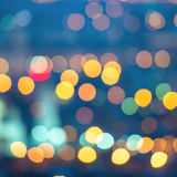 Abstract blue circular bokeh background, city lights with horizo Royalty Free Stock Photography