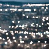 Abstract blue circular bokeh background, city lights in the twil Stock Images
