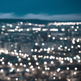 Abstract blue circular bokeh background, city lights in the twil. Ight with horizon, closeup royalty free illustration