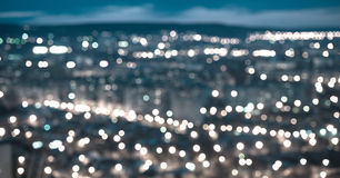 Abstract blue circular bokeh background, city lights in the twilight with horizon, panorama stock image