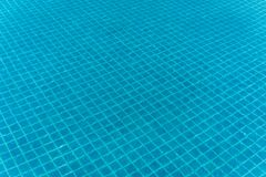 Abstract blue color water background. Pattern in swimming pool background stock photos
