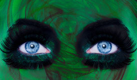 Abstract blue eyes makeup woman green texture stock photo