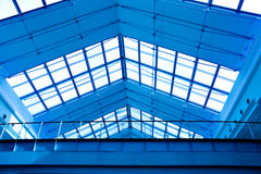 Abstract blue geometric ceiling. In office center Royalty Free Stock Photos