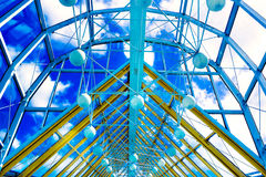 Abstract blue geometric ceiling. In office center Stock Images