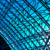Abstract blue geometric ceiling in office center stock image
