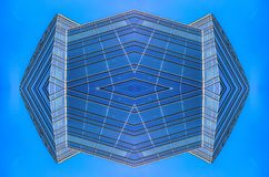 Abstract blue glass building in downtown grid royalty free stock photo