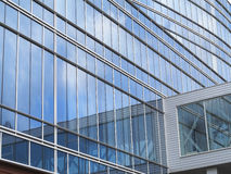 Abstract blue glass facade modern business center building Stock Photography