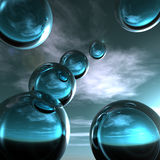 Abstract Blue Glass Spheres. Cool abstract blue glass spheres against the horizon Stock Images