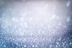 Abstract blue glitter bokeh background with shimmering light bubbles.  stock images