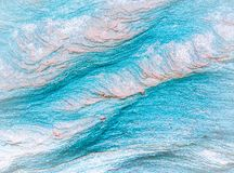 Abstract blue, gray, orange and green background - layers of rocks. Exposed by sea in Northumberland royalty free stock photography