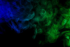 Abstract blue and green smoke hookah on a black background. Stock Images