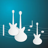 Abstract Blue Music Background. Guitars and Staff Made from Paper Royalty Free Stock Photography
