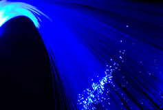 Abstract blue optic fibre background Stock Images