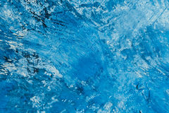 Abstract blue paint strokes on the background Stock Images