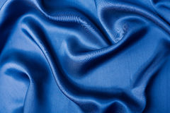 Abstract blue silk background Stock Images
