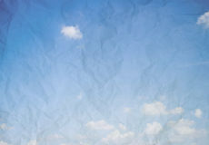 Abstract blue sky background. Wrinkled paper image of cloudy sky Stock Image