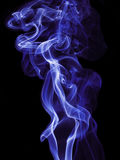 Abstract blue smoke. Isolated on black background Stock Photo