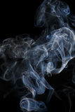 Abstract blue smoke from aromatic sticks. Stock Image