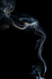 Abstract blue smoke from aromatic sticks. Stock Photos