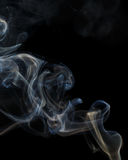 Abstract blue smoke from aromatic sticks. Royalty Free Stock Photos