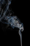 Abstract blue smoke from aromatic sticks. Stock Images