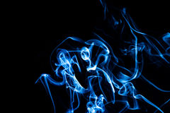 Abstract blue smoke background. Bright colorful abstract smoke background isolated on  a black background Stock Images