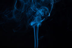 Abstract blue smoke on black Stock Image