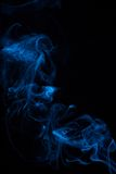 Abstract blue smoke on black Royalty Free Stock Photography