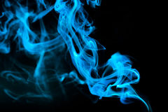 Abstract Blue smoke. On a black background Royalty Free Stock Photos