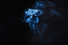 Abstract  Blue Smoke on black background Stock Photography
