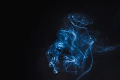 Abstract  Blue Smoke on black background Stock Image
