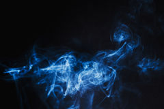 Abstract  Blue Smoke on black background Royalty Free Stock Photos