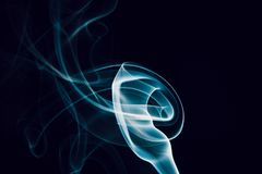 Swirls of blue smoke on a black background Royalty Free Stock Images