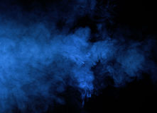 Abstract blue smoke on a dark background. Blue smoke background Royalty Free Stock Images