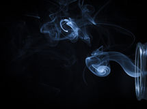 Abstract Blue Smoke Flowing From Bottle Background Royalty Free Stock Photography