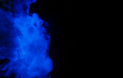 Abstract blue smoke hookah on a black background. Royalty Free Stock Images