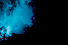 Abstract blue smoke hookah on a black background. Royalty Free Stock Image