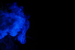 Abstract blue smoke hookah on a black background. Stock Photos