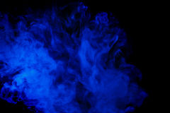 Abstract blue smoke hookah on a black background. Royalty Free Stock Photos