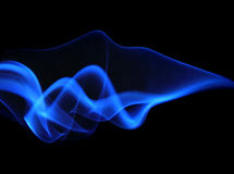 Abstract blue  smoke isolated on black Stock Photos