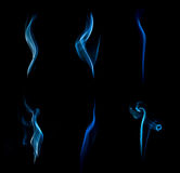Abstract blue smoke isolated on black background. Royalty Free Stock Photography