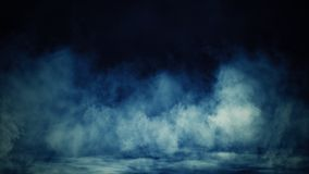 Abstract blue smoke mist fog on a black background. Texture. Design element.
