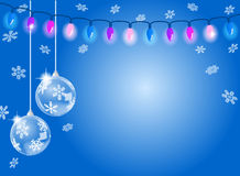 Abstract blue snowflake background with two christmas baubles Royalty Free Stock Image