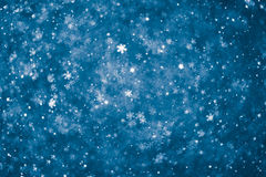 Abstract blue snowflakes background. With multitude of particles royalty free stock photography