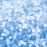 Abstract blue sparkles defocused background royalty free stock photography